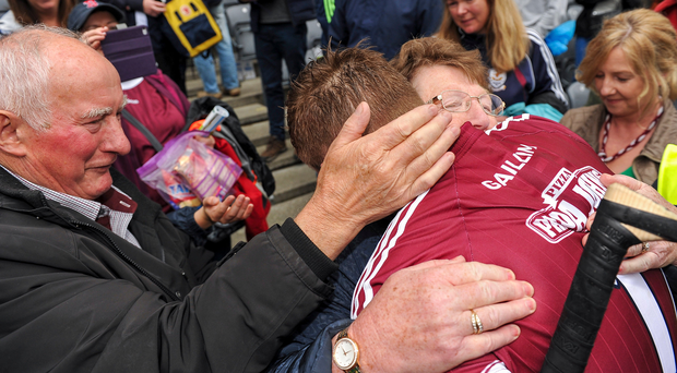 Joe Canning of Galway is congratulated by his parents Sean and Josephine, following the GAA Hurling All-Ireland Senior Championship Semi-Final match between Galway and Tipperary at Croke Park in Dublin. Photo by Sam Barnes/Sportsfile