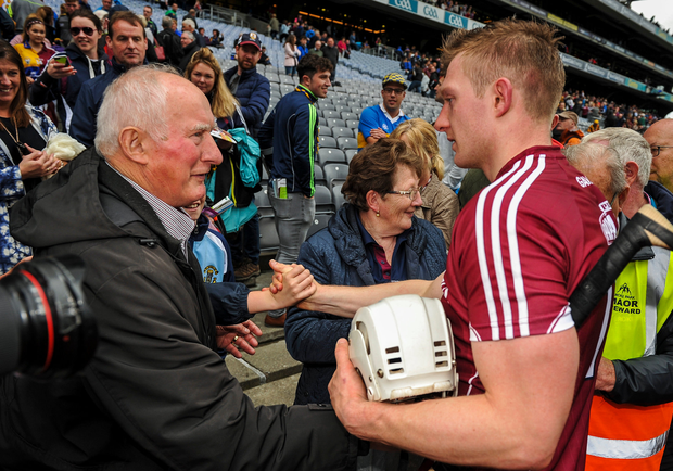 Joe Canning of Galway is congratulated by his parents, Sean and Josephine, following the GAA Hurling All-Ireland Senior Championship Semi-Final match between Galway and Tipperary at Croke Park in Dublin. Photo by Sam Barnes/Sportsfile