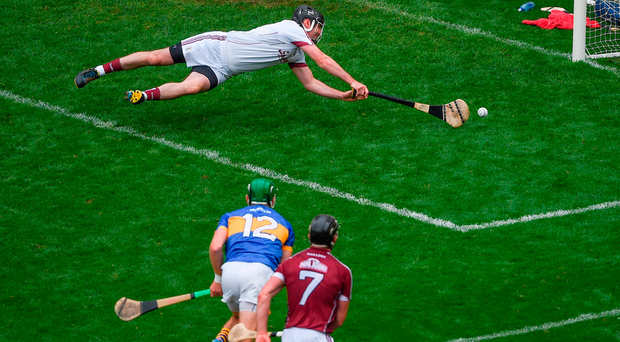 Cillian O'Connor of Mayo attempts a kick at scoring a point, which ultimately went wide, in the very last minute. Photo: Sportsfile