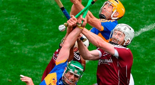 John O'Dwyer, and Séamus Callanan of Tipperary in action against Daithí Burke, left, and John Hanbury of Galway during the GAA Hurling All-Ireland Senior Championship Semi-Final match between Galway and Tipperary at Croke Park in Dublin. Photo: Sportsfile