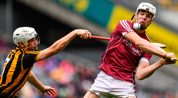 Jack Canning of Galway is tackled by Michael Carey of Kilkenny during the Electric Ireland GAA Hurling All-Ireland Minor Championship Semi-Final match between Kilkenny and Galway at Croke Park in Dublin. Photo: Sportsfile