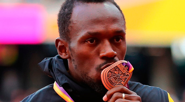 Usain Bolt wasted little time in congratuling Justin Gatlin. Photo: Getty Images