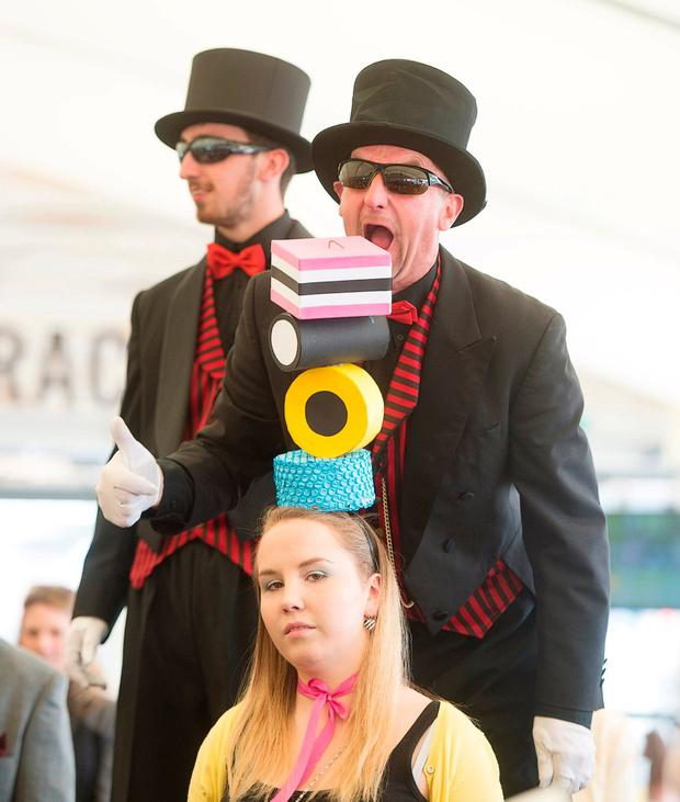 Mad Hatter Leah McEvoy with two hungry admirers. Photo: Andrew Downes