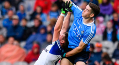 Dublin's Brian Fenton battles Darren Hughes of Monaghan for possession of the ball. Photo: Sportsfile