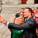 Ireland captain Claire Molloy takes a selfie with Taoiseach Leo Varadkar and some of the captains of the other teams taking part in the Women's Rugby World Cup. Photo: Sportsfile