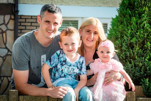 Michael Fox with his wife, Lisa; four-year-old son, Jack, and daughter, Perrie, aged eight months. Perrie contracted viral meningitis at one week old. Pic: Arthur Carron