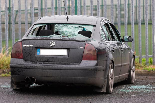 A car with smashed windows nearby. Photo: Eamon Ward