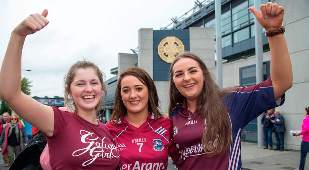 Delighted Galway fans Allie Glennon, Vecky Gilchreest and Gemma Carrick at Croke Park. Photo: Colin O'Riordan