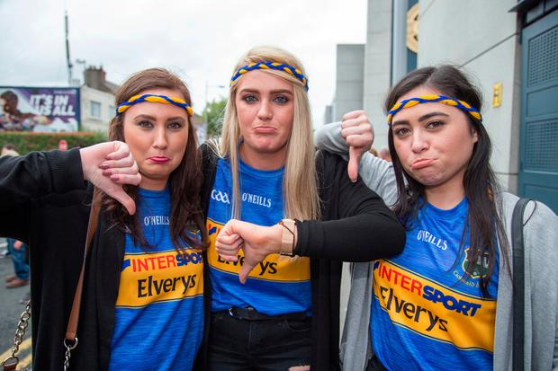 Disappointed Tipp fans Nicola Kearney, Teigan Stephens and Stephanie Power. Photo: Colin O'Riordan