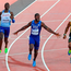 American Justin Gatlin (second left) stretches his arms out to celebrate his victory in the 100m final at the World Championships on Saturday. Photo by Stephen McCarthy/Sportsfile