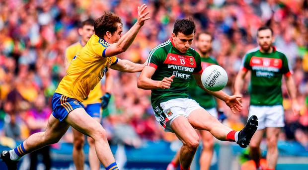 Jason Doherty of Mayo in action against David Murray of Roscommon during the GAA Football All-Ireland Senior Championship Quarter Final replay match between Mayo and Roscommon at Croke Park in Dublin. Photo by Ramsey Cardy/Sportsfile