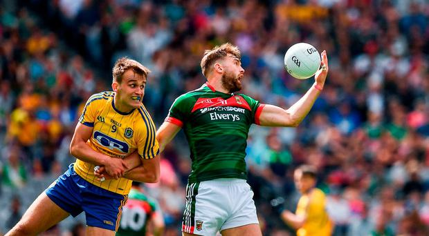 Aidan O'Shea of Mayo in action against Enda Smith of Roscommon during the GAA Football All-Ireland Senior Championship Quarter-Final Replay match between Mayo v Roscommon at Croke Park, in Dublin. Photo by Ray McManus/Sportsfile