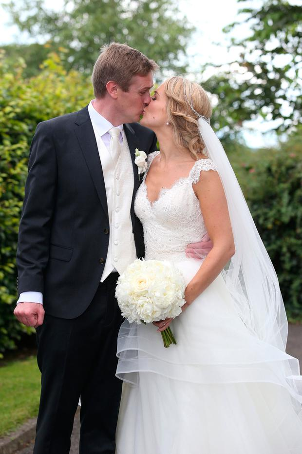 Helen McEntee and Paul Hickey kiss after their wedding at St Patrick's Church in Meath. Picture credit; Damien Eagers 7/8/2016
