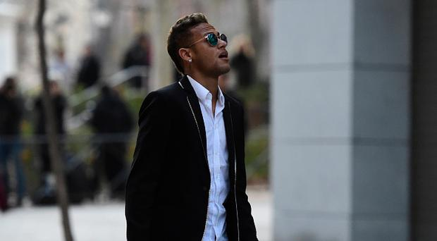 Barcelona's Brazilian forward Neymar leaves Spain's national court in Madrid on February 2, 2016. AFP PHOTO/ JAVIER SORIANO / AFP / JAVIER SORIANO (Photo credit should read JAVIER SORIANO/AFP/Getty Images)