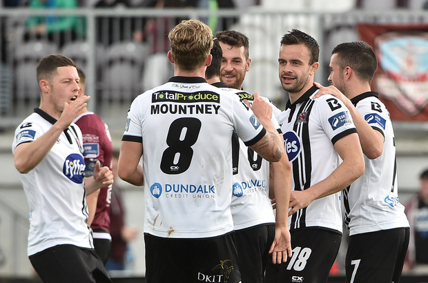 Robbie Benson, second from right, of Dundalk celebrate after scoring his side's second goal with teammates Shane Grimes and John Mountney during the EA Sports Cup semi-final match between Galway United and Dundalk at Eamonn Deasy Park, in Galway. Photo by David Maher/Sportsfile