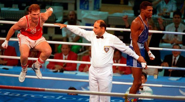 Michael Carruth jumps for joy after being crowned Olympic welterweight champion in Barcelona
