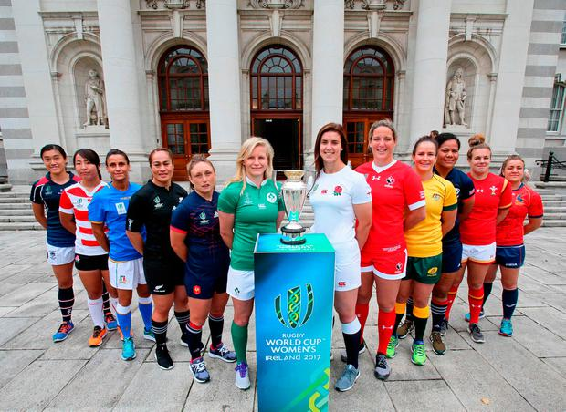 The international captains pose with the World Cup trophy ahead tomorrow's kick-off in Dublin. Pic: Getty Images