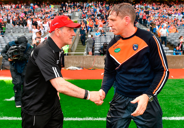 Tyrone manager Mickey Harte shakes hands with Armagh manager Kieran McGeeney following their All-Ireland SFC quarter-final at Croke Park last Saturday. Photo by Ramsey Cardy/Sportsfile