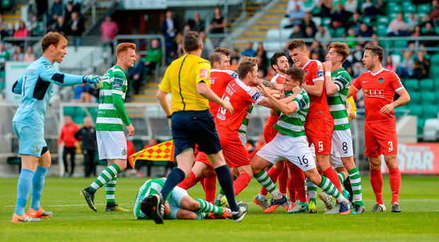 Players from both teams tussle after an off the ball incident between Alan Bennett and David Webster (on the ground) for which the Cork City player was sent off. Photo by Piaras Ó Mídheach/Sportsfile