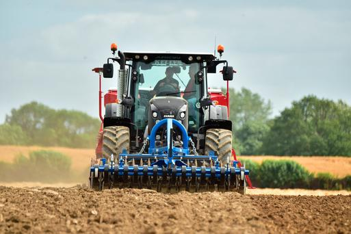 Wayne Barry getting the ground ready for the next crop of fodder rape for farmer Clive Bailey from Ballaghmoyler, Co Carlow. Photo Roger Jones.
