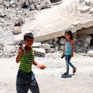 Children play amid the rubble inside a refugee camp in a rebel-held part of the southern city of Deraa, Syria. Photo: Reuters/Alaa al-Faqir