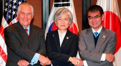 US secretary of state Rex Tillerson, South Korea's Foreign Minister Kang Kyung-Wha and Japan's Foreign Minister Taro Kono in Manila. Photo: Getty