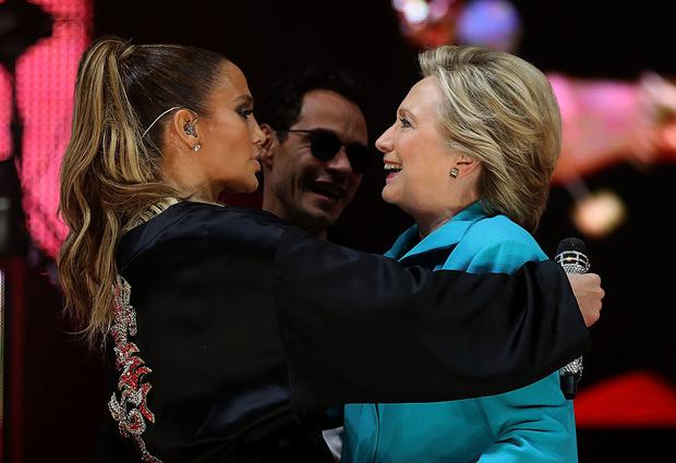 Democratic presidential nominee embraces singer Jennifer Lopez during a Get Out The Vote concert on October 29, 2016 in Miami, Florida. Photo by Justin Sullivan/Getty Images