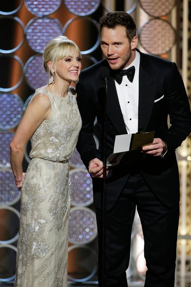 Presenters Anna Faris and Chris Pratt speak onstage during the 72nd Annual Golden Globe Awards at The Beverly Hilton Hotel on January 11, 2015 in Beverly Hills, California. (Photo by Paul Drinkwater/NBCUniversal via Getty Images)