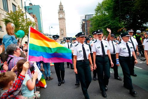 Members of the PSNI and Garda join the Pride parade as it makes it's way through Belfast city centre. PRESS ASSOCIATION Photo. Picture date: Saturday August 5, 2017. See PA story ULSTER Pride Parade. Photo: Peter Morrison/PA Wire