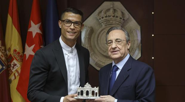 Cristiano Ronaldo (L) poses with president Florentino Perez after signing a five-year contract renewal until 2021 for Real Madrid FC at Santiago Bernabeu Stadium on November 7, 2016 in Madrid, Spain. (Photo by Angel Martinez/Real Madrid via Getty Images)