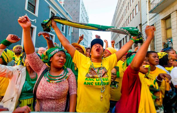 African National Congress (ANC) protesters in support of President Jacob Zuma, watch on a large screen outside parliament in Cape Town South Africa, Tuesday Aug. 8, 2017. South Africa's parliament prepared to vote Tuesday on a motion of no confidence in embattled South African President Jacob Zuma that could force him to resign after months of growing anger over alleged corruption. (AP Photo)