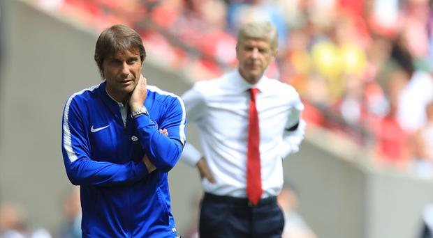 Arsenal versus Chelsea; Chelsea Manager Antonio Conte in deep thought as Wenger passes behind him (Photo by Shaun Brooks/Action Plus via Getty Images)