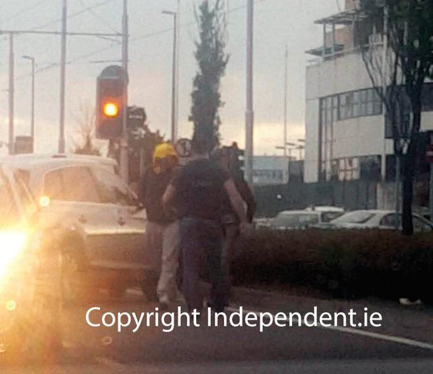 Gardaí escort the raider from the vehicle. picture: Independent.ie