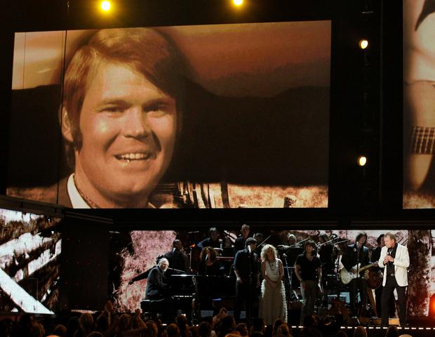 FILE PHOTO: Glen Campbell (R) takes the stage with The Band Perry during a tribute at the 54th annual Grammy Awards in Los Angeles, California, U.S.,February 12, 2012. REUTERS/Mario Anzuoni/File Photo