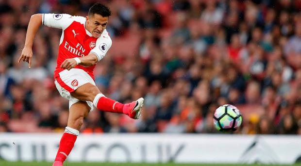 There have been questions over whether Alexis Sanchez would remain at Arsenal this summer Photo: ADRIAN DENNIS/AFP/Getty Images