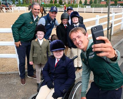Irish show jumper Bertram Allen takes a selfie with, from left, team manager Rodrigo Pessoa, show jumper Cian O'Connor, and members of the Riding for the Disabled Association Ireland, Lynn Frain (13), from Mullingar; Oisín O'Connell (7), from Clashmore, Waterford; Niamh Carolan (25), from Navan; Stephen Carroll (22), from Dungarvan, Waterford; and Gemma Haire (17), from Inistioge, Kilkenny. Photo: Damien Eagers