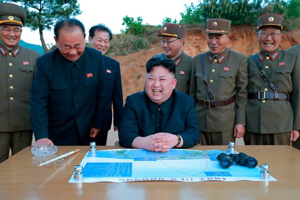 North Korean leader Kim Jong Un is pictured during the long-range strategic ballistic rocket Hwasong-12 (Mars-12) test launch in this undated photo released by North Korea's Korean Central News Agency (KCNA). Photo: Reuters