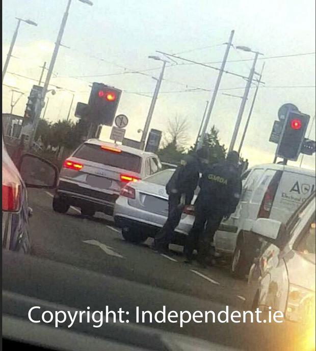 Gardai use two vehicles to cut off the path of the suspect van on the Kylemore Road in Dublin. Picture: Independent.ie
