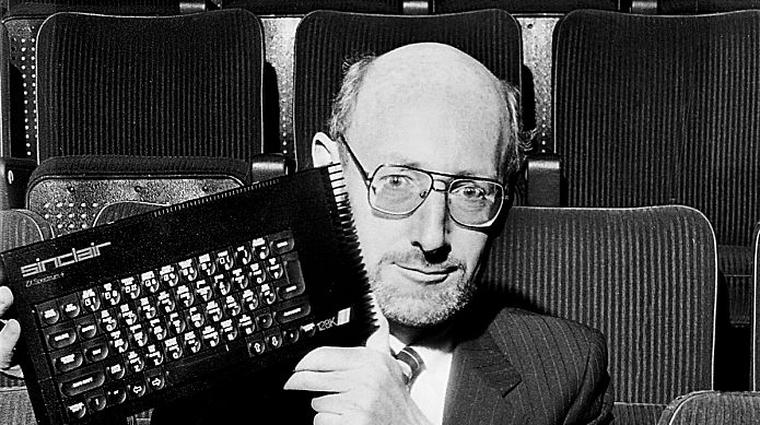 Sinclair founder Sir Clive Sinclair holds up a Sinclair ZX Spectrum 128 home computer, United Kingdom, 1986. (Photo by Dick Barnatt/Getty Images)