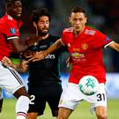 Real Madrid's Isco in action with Manchester United's Nemanja Matic and Paul Pogba REUTERS/Peter Cziborra
