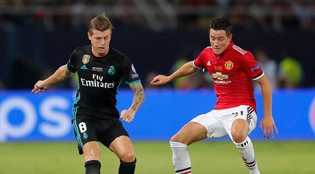 SKOPJE, MACEDONIA - AUGUST 08: Toni Kroos of Real Madrid and Ander Herrera of Manchester United battle for possession during the UEFA Super Cup final between Real Madrid and Manchester United at the Philip II Arena on August 8, 2017 in Skopje, Macedonia. (Photo by Boris Streubel - UEFA/UEFA via Getty Images)