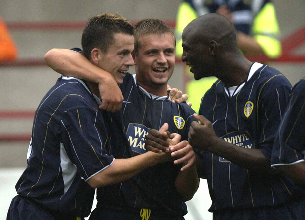 Leeds United's Ian Harte, left, celebrates with team-mates Zoumana Camara and Stephen McPhail after scoring his sides equalizing goal against Aston Villa. Dublin Tournament Semi-Final, Leeds United v Aston Villa, Tolka Park, Dublin. Picture credit; Pat Murphy / SPORTSFILE *EDI*