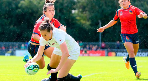 England's Emily Scarratt scores her side's fifth try during the 2017 Women's Rugby World Cup, Pool B match at the UCD Bowl, Dublin. PRESS ASSOCIATION Photo. Picture date: Wednesday August 9, 2017. Brian Lawless/PA Wire.
