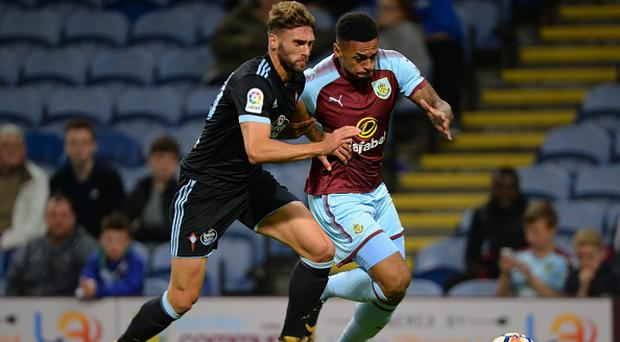 BURNLEY, ENGLAND - AUGUST 01: Andre Gray of Burnley and Sergi Gomez of Celta Vigo in action during the pre-season friendly match between Burnley and Celta Vigo at Turf Moor on August 1, 2017 in Burnley, England. (Photo by Nathan Stirk/Getty Images)