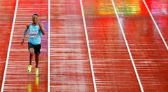 Botswana's Isaac Makwala runs alone in his 200m 'time trial' where he qualified for the semi-finals. Photo: Getty