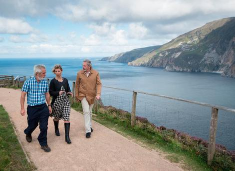 PBS presenter Samantha Brown at Sliabh League in Donegal with local guide Paddy Clarke, left, and Liam Campbell from Fáilte Ireland. Photo: Clive Wasson