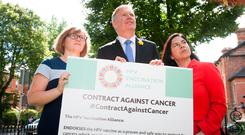 Left to right: Orla O'Connor, National Women's Council of Ireland, Donal Buggy, Irish Cancer Society, and Tanya Ward, Children's Rights Alliance, during a briefing to sign a Contract against Cancer. Photo: Gareth Chaney