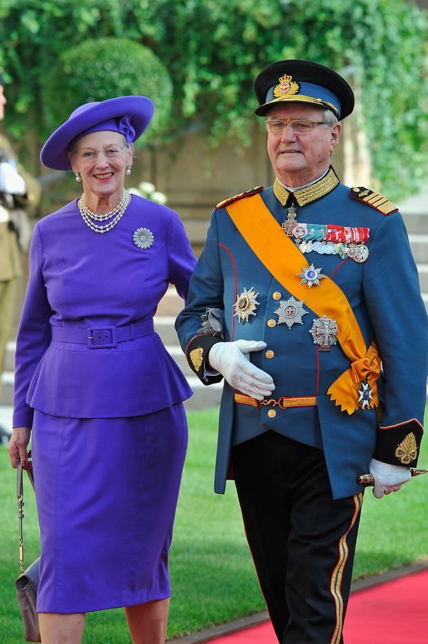 Queen Margarethe of Denmark and Prince Henrik of Denmark emerge from the Cathedral following the wedding ceremony of Prince Guillaume of Luxembourg and Princess Stephanie of Luxembourg at the Cathedral of our Lady of Luxembourg on October 20, 2012 in Luxembourg, Luxembourg