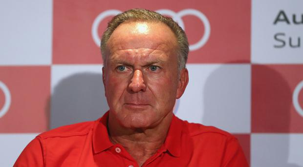Karl-Heinz Rummenigge, CEO of FC Bayern Muenchen attends a press conference at JW Marriott Singapore South Beach Hotel during the Audi Summer Tour 2017 on July 27, 2017 in Singapore. (Photo by Alexander Hassenstein/Bongarts/Getty Images)