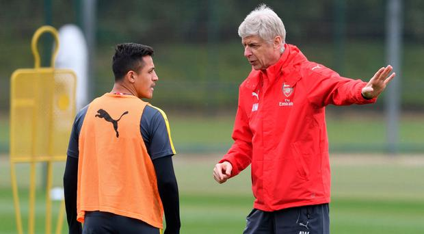 Alexis Sanchez (left) has long-announced his world class but Arsene Wenger still lacks players to take hold of a title race and may not hold onto the Chile striker for much longer. Photo: Stuart MacFarlane/Arsenal FC via Getty Images
